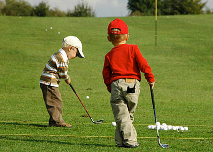 2 Little Boys Playing Golf