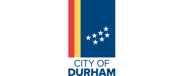 City of Durham Logo - Navy blue sans-serif type with red, yellow, and blue flag with white stars above