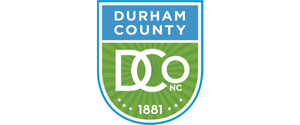 Durham County Logo - Shield shaped mark in blue and green with white sans-serif type inside