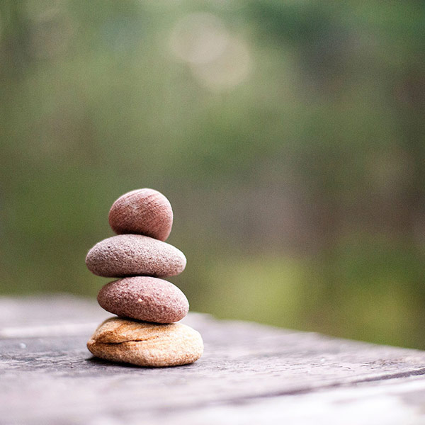 Stacked Stones On A Wooden Table
