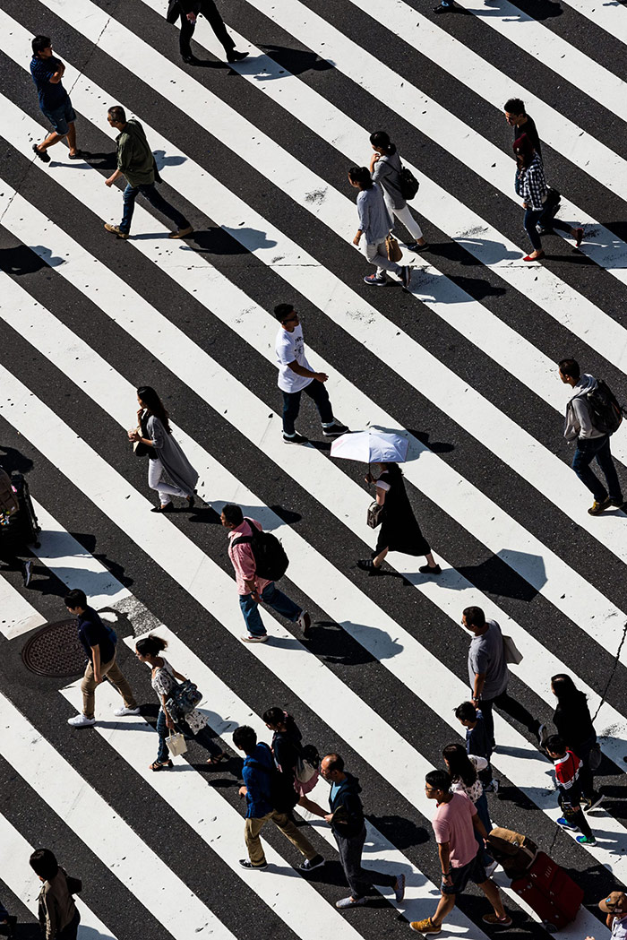 People Walking on striped paved area